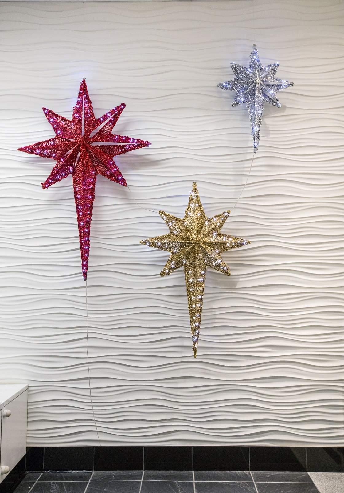 Creative sculptures and 3D letters come together to light up this contemporary lobby through the holiday season