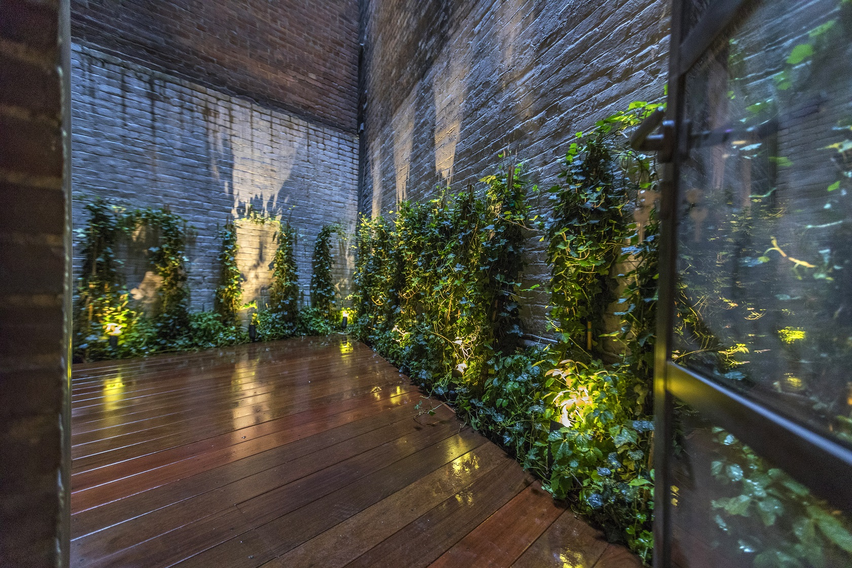 This New York City micro space, nestled between buildings in Tribeca, is transformed into a secret garden