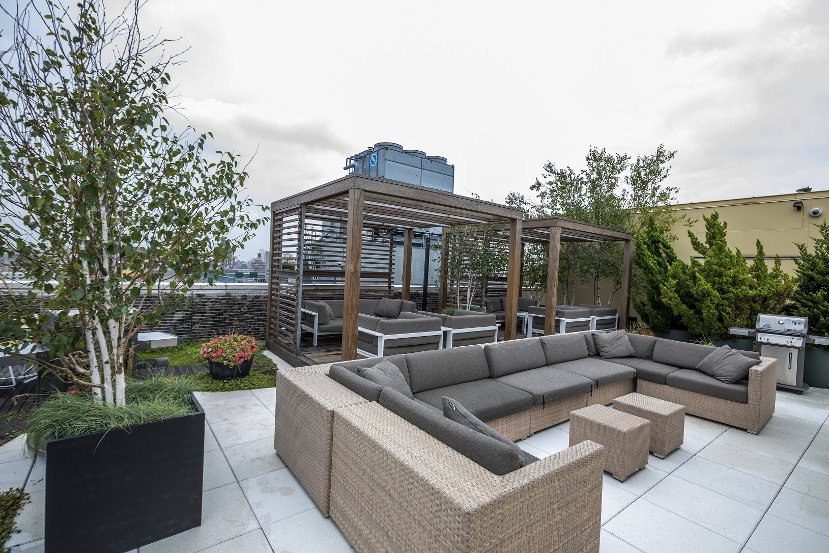 Expertly maintained specimen trees mix with perennials to encompass this sizeable outdoor rooftop, providing entertainment area