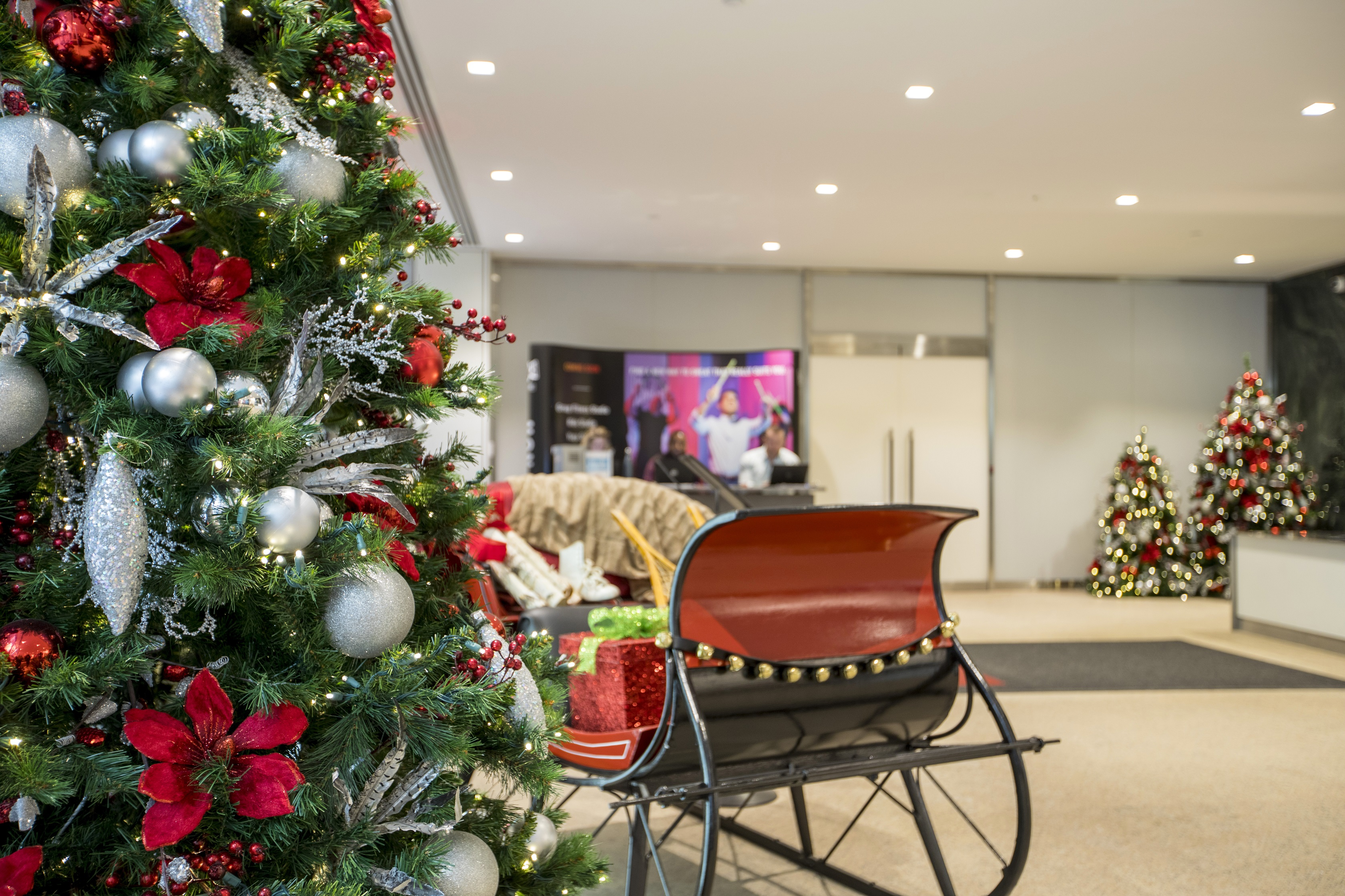 Classic Holiday Elements blend with sleek modern décor to create the perfect look for this commercial lobby space.