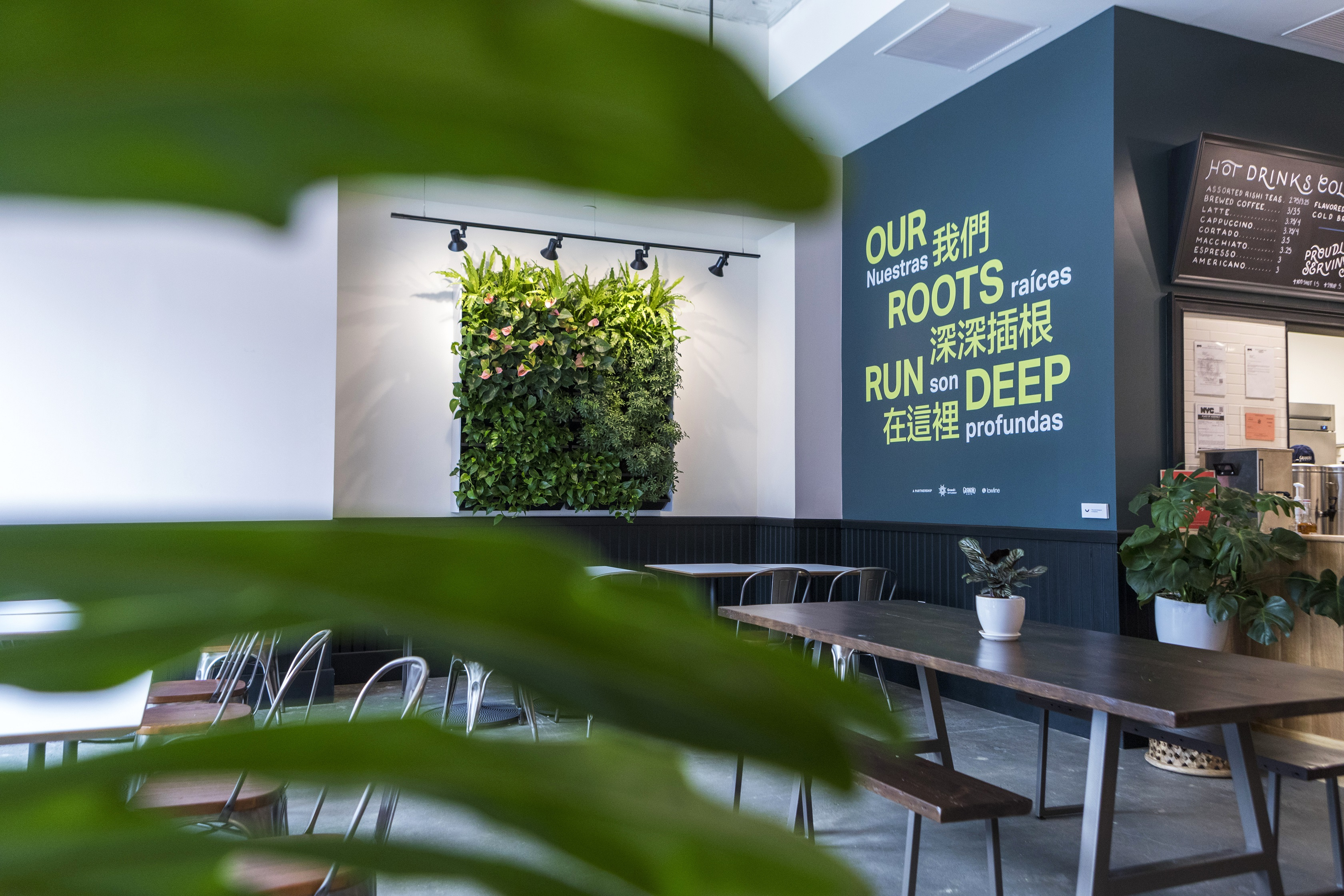 The introduction of crisp green plants into this café create a great conversation piece as customers catch up with friends.