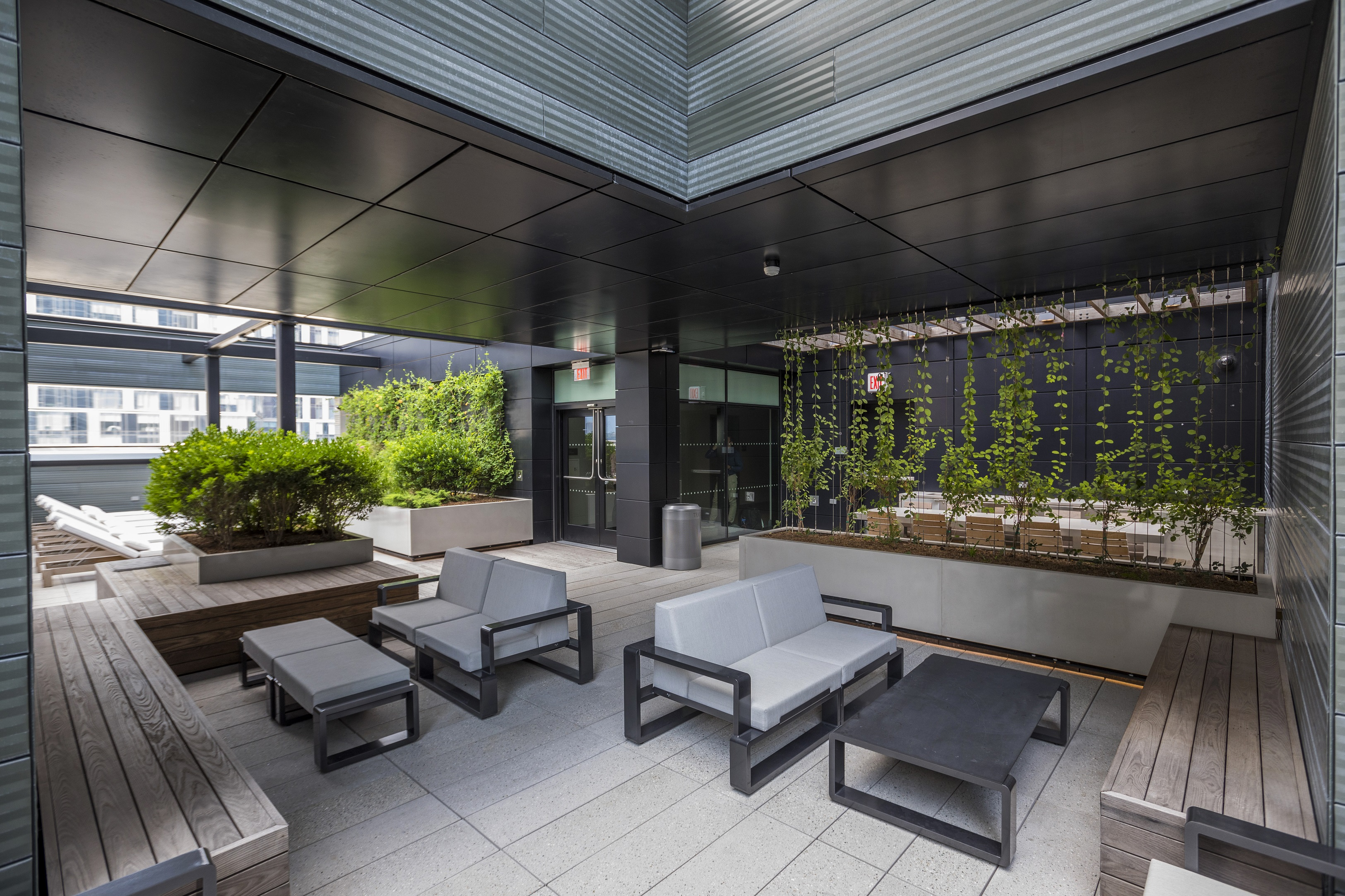 This charming terrace is sure to peak your interest with its pixel plant boxes and climbing vines.
