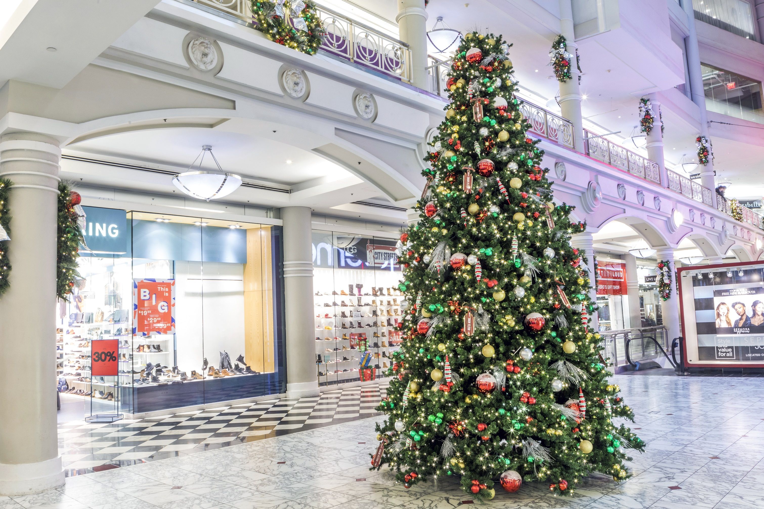 Holiday cheer resonates through the great hall of this shopping center sparking joy and excitement for visitors big and small.