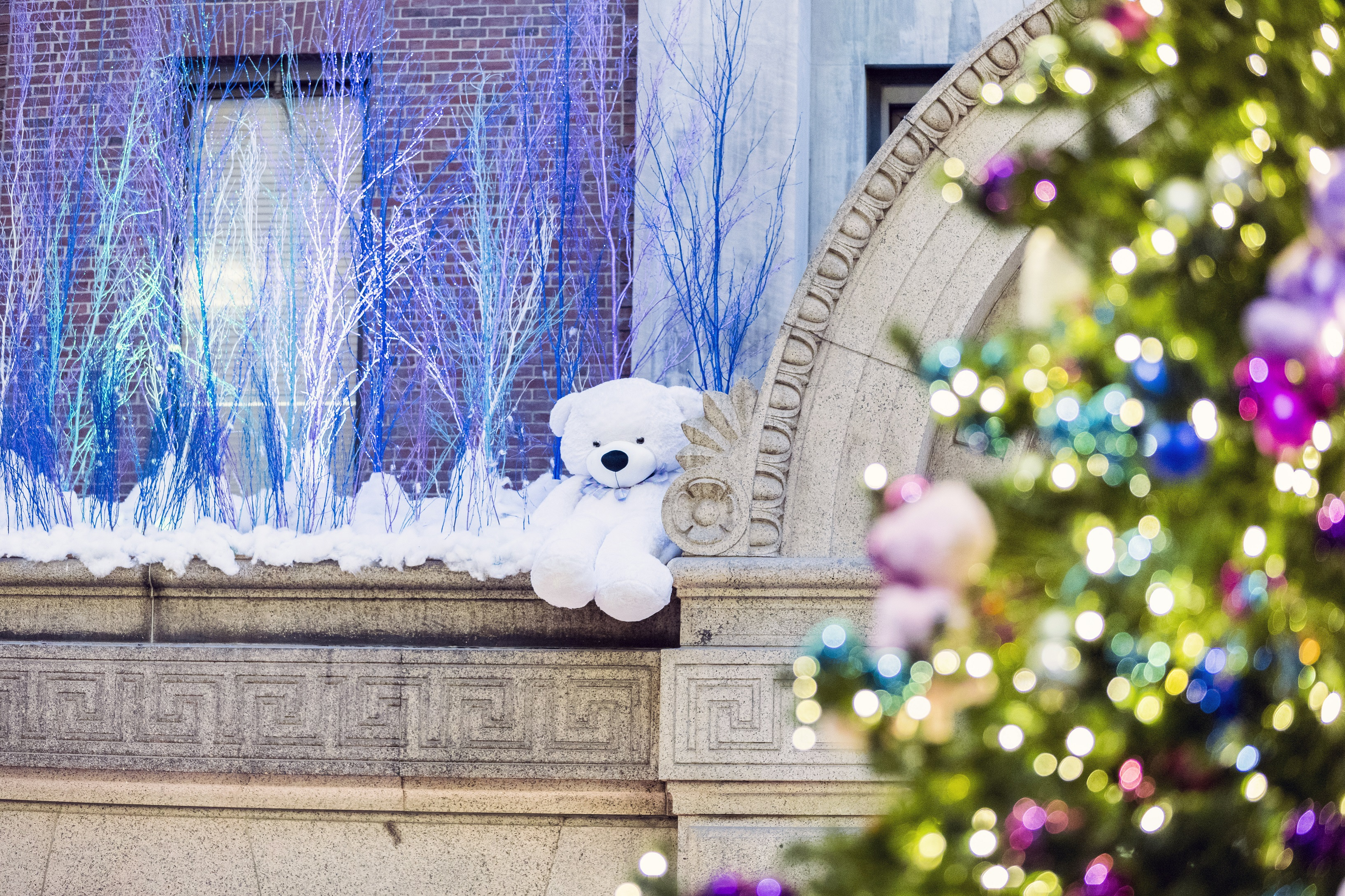 The custom theme of this frozen forest fantasy creates a winterscape filled with jewel tones and teddy bears.